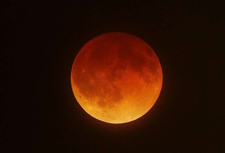 This is what San Franciscans would have seenin the sky early Tuesday if it hadn't been for the cloud cover. In Los Angeles, however, the blood moon, a total lunar eclipse, put on quite a show for night owls. Photo: Joe Klamar, AFP/Getty Images