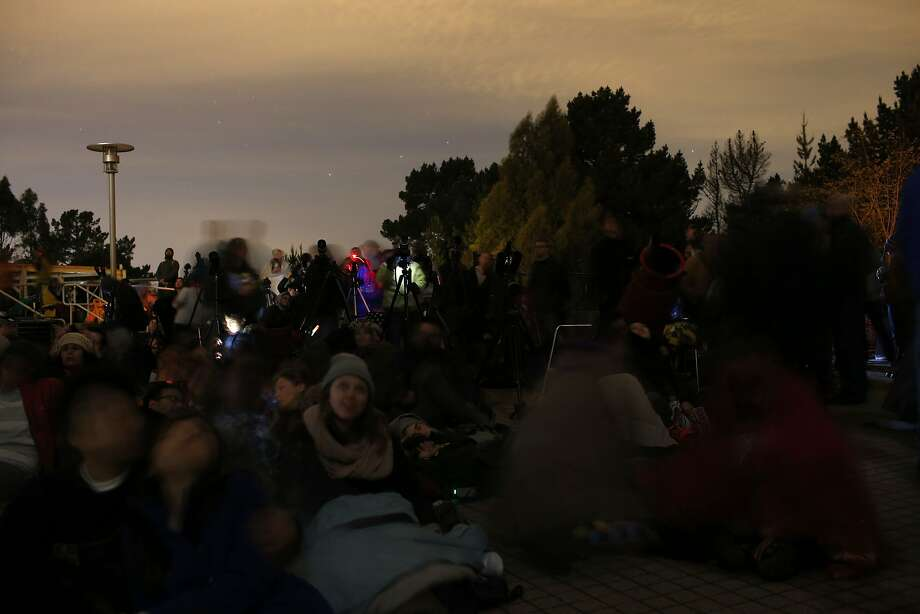 People gather at the Chabot Space and Science Center for a glimpse of the total lunar eclipse in Oakland, California April 14, 2014. The lunar eclipse on Tuesday will unfold over three hours when the moon begins moving into Earth's shadow. A little more than an hour later, the moon will be fully eclipsed and shrouded in an orange, red or brown glow. Photo: Stephen Lam, Reuters