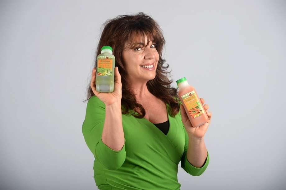 Sabrina Dionne holds juice made by her company Juicn4U Photo taken Guiseppe Barranco/@spotnewsshooter