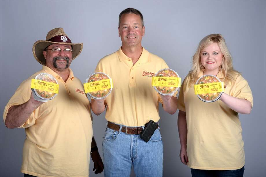 From left, Greg Prejean, Fred Bebeau and Lauren Bebeau hold out their frozen gumbo.  Photo taken Guiseppe Barranco/@spotnewsshooter