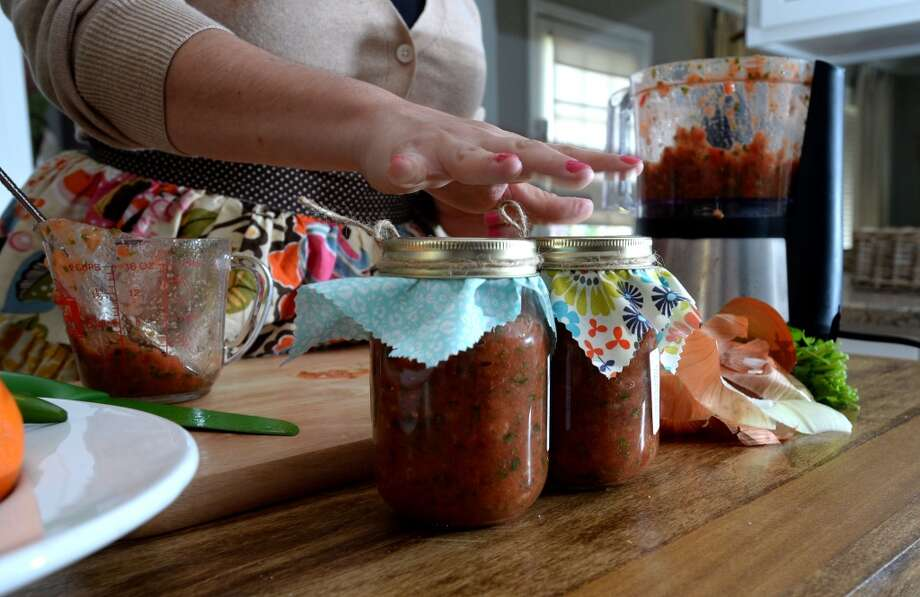 Owner of Fresh, Lauren Hallmark prepares three types of salsa from her home. Mild, hot and tomatillo, Hallmark said she makes 60 to 80 jars a week. Photo taken Wednesday, April 2, 2014 Guiseppe Barranco/@spotnewsshooter