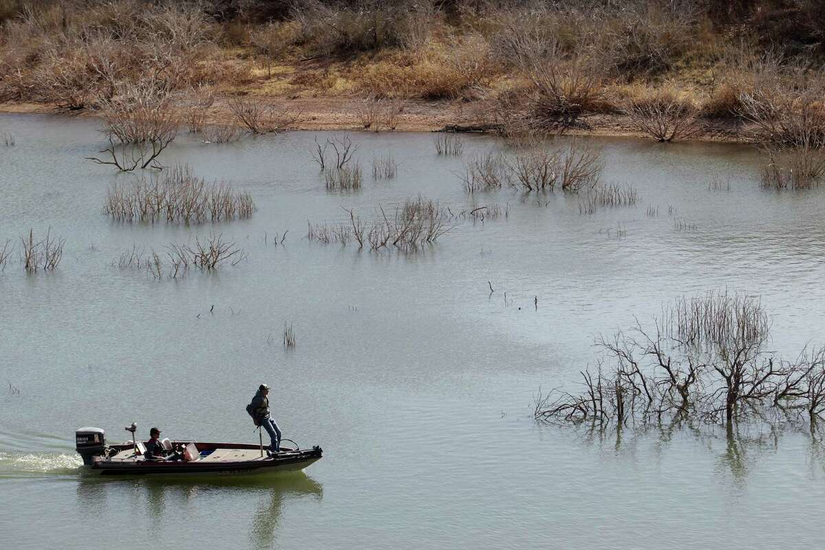 In this March 18, 2014 photo, fishermen troll for their next catch at Lake Alan Henry in Texas. The lake lost roughly 4 billion gallons of water to evaporation in 2011, thanks to a lingering drought and sweltering temperatures and still more water is simply missing, according to federal government data.