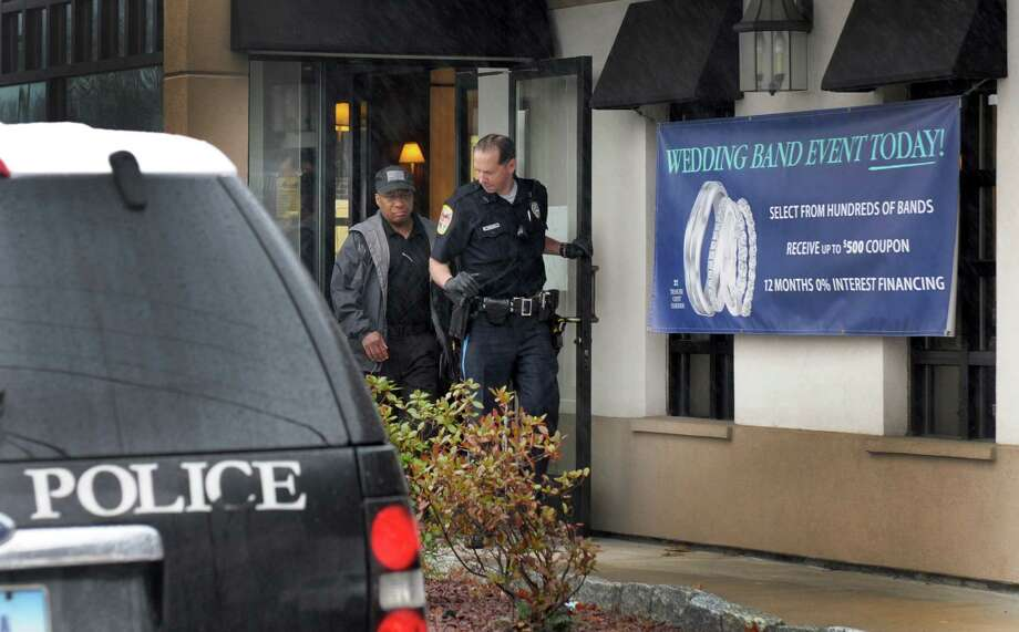 Danbury Police investgate at holdup at Michael's Jewelers on Federal Road in Danbury Tuesday morning, April 15, 2014. Photo: Carol Kaliff / The News-Times