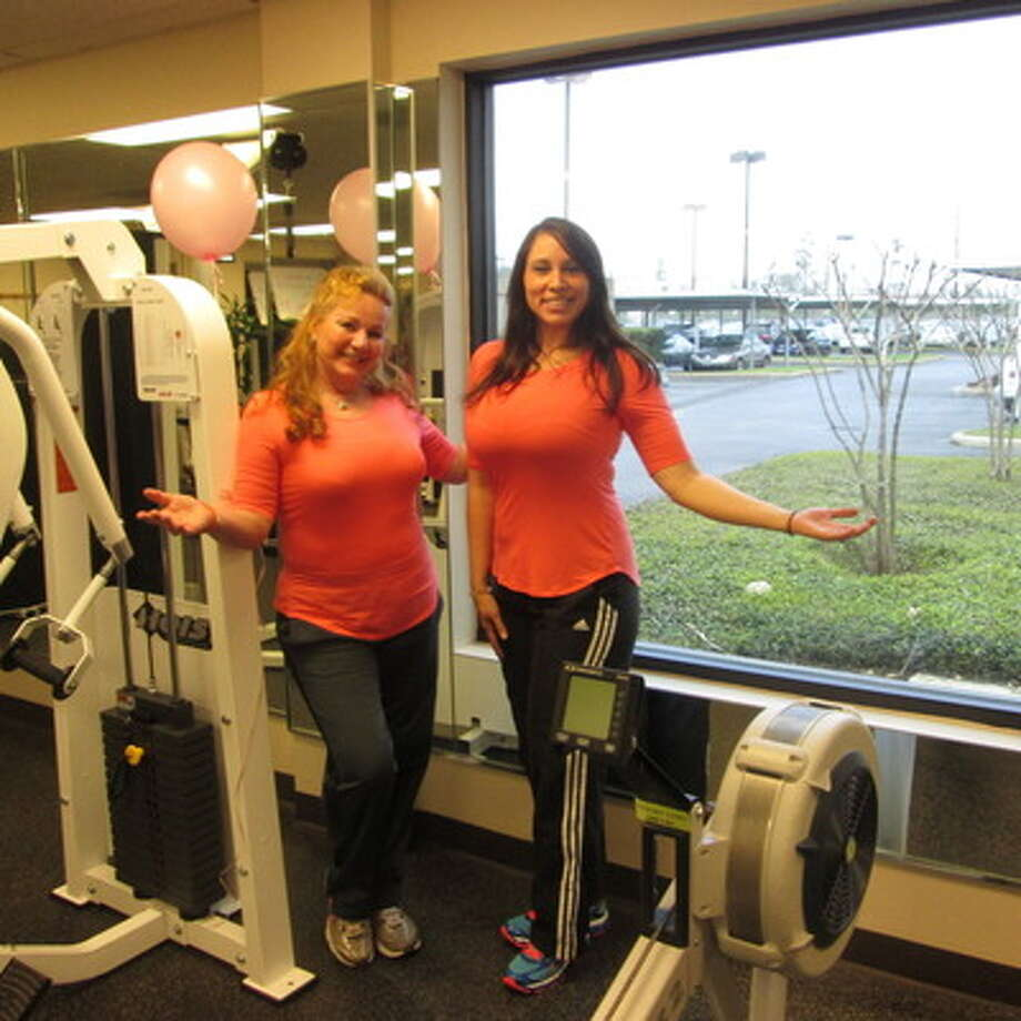 Andrea Walker, left, and Jessica Labrada show off the new look of the Wellness Center.