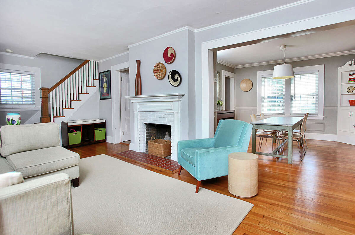 The living room at 357 Meadowbrook Road features a fireplace.
