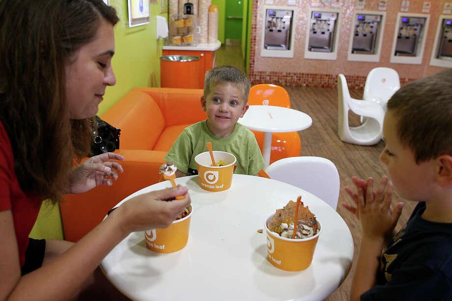 Orange LeafFreebie: Cups of yogurt are $4.15 regardless of weight. Photo: Cynthia Esparza, For San Antonio Express-News / For San Antonio Express-News