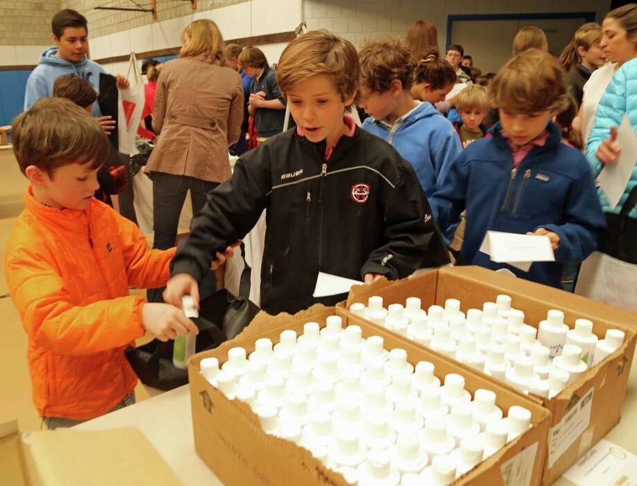New Canaan Country School students work together to assemble emergency kits for AmeriCares as part of an ongoing service learning partnership. Photo: Picasa, Contributed / New Canaan News Contributed