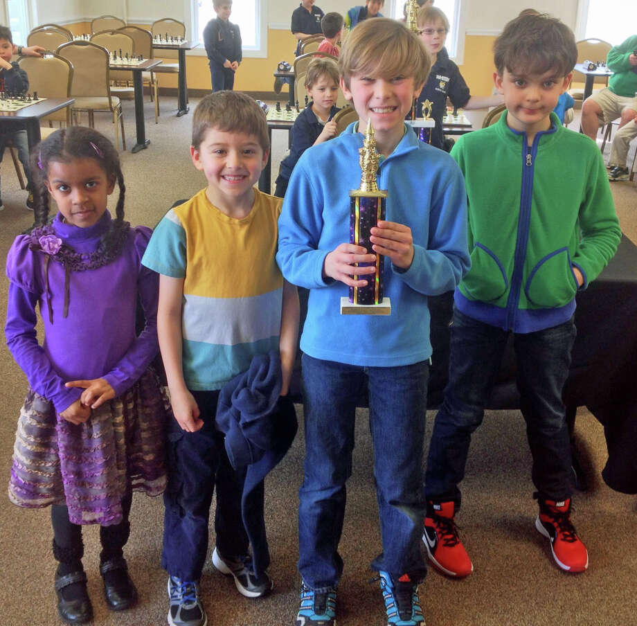New Canaan Country School students took home second place at the Fairfield County Invitational K-5 Team Chess Championship Feb. 23 at the Chess Club of Fairfield County in Norwalk. The school's team was comprised of four Lower School students, from left, Tiffany Jennings, Cyrus Pearson, Justin Higgins and Jackson Benett. The students, who attend the school's weekly after-school chess program, played four rounds against teams from six other area schools. Photo: Contributed Photo, Contributed / New Canaan News Contributed