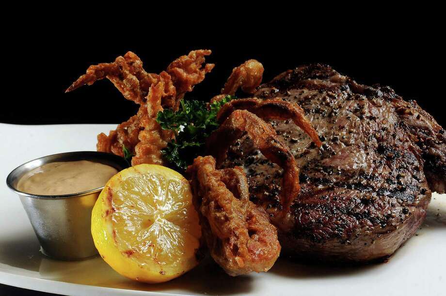 Mr. Peeples' 20-ounce Cowboy Ribeye (with soft-shell crab) was good but, at $90, should have been great. Photo: Dave Rossman, Freelance / Freelance