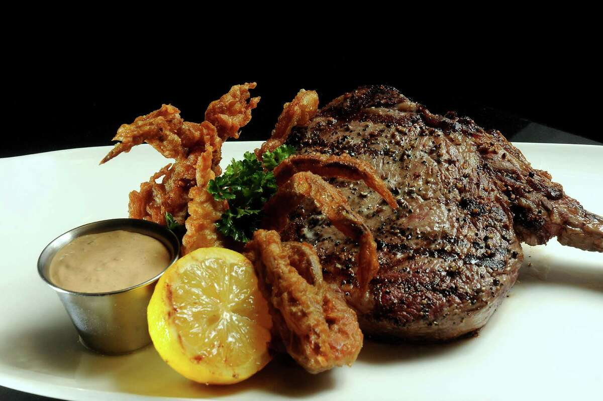 The 20 oz Cowboy Ribeye with a soft-shell crab at Mr. Peeples at 1911 Bagby Wednesday April 09, 2014.(Dave Rossman photo)