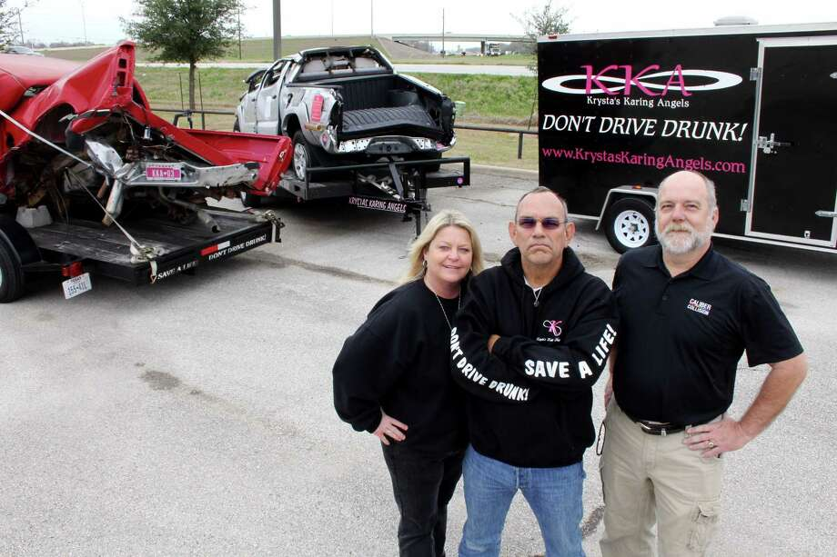 Terri and Mark Rodriguez founded the organization Krysta's Karing Angels in memory of their daughter Krysta Rodriguez who was killed by a drunken driver on Feb. 11, 2010.  On the right is Tim Wilkins, manager of Caliber Collision in Katy. Behind them are wrecked vehicles that were driven by individuals killed by drunken drivers.  Terri and Mark Rodriguez founded the organization Krysta's Karing Angels in memory of their daughter Krysta Rodriguez who was killed by a drunken driver on Feb. 11, 2010.  On the right is Tim Wilkins, manager of Caliber Collision in Katy. Behind them are wrecked vehicles that were driven by individuals killed by drunken drivers. Photo: Suzanne Rehak, Freelance Photographer