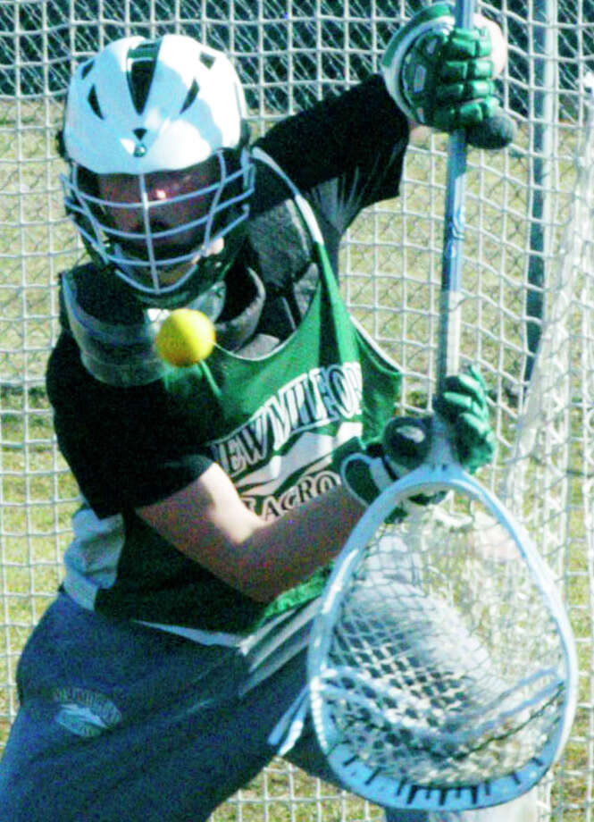 Green Wave senior Harrison O'Connell demontrates the quick hands that should allow him to make the transition to goaltender for New Milford High School boys' lacrosse this spring. April 2014 Photo: Norm Cummings / The News-Times