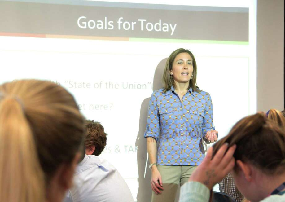 Dawn Kurth, of No Kidding Nutrition, engaged St. Luke's School students in a demonstration that tested their knowledge of added sugars in many common beverages and snacks. Photo: Contributed Photo, Contributed / New Canaan News Contributed