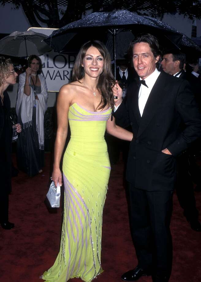 Hugh Grant was one of the most notorious cheaters of the '90s when he was caught with prostitute Divine Brown in a car parked on Sunset Blvd. Grant was in a relationship with Elizabeth Hurley at the time. The couple split in 2000. Photo: Ron Galella, Ltd., WireImage