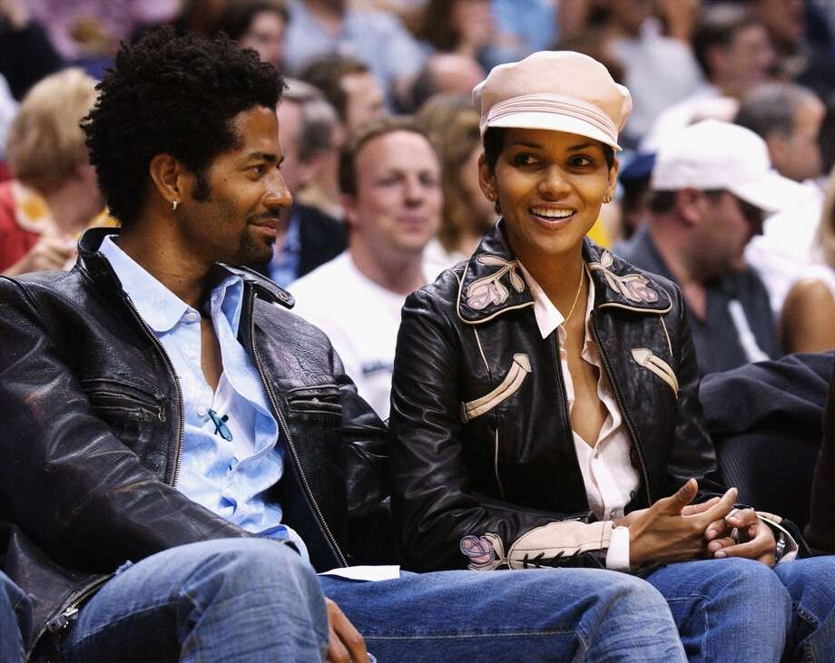 Halle Berry  and husband musician Eric Benet were married from 2001-2005. Almost from the beginning of their marriage rumors of Benet's cheating were widely circulated. Like Bullock, Berry separated from Benet after her Academy Award win. Photo: Vince Bucci, Getty Images