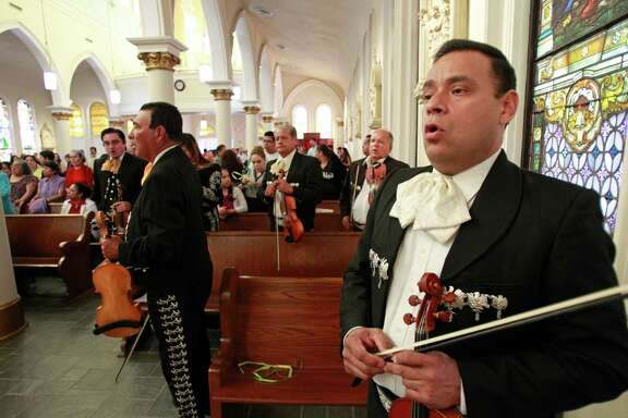 Maurice Vasquez, right, singing as he performs with others members of Mariachi Norteño during the mariachi Mass at St Joseph's Catholic Church, 1505 Kane St, Sunday, April 13, 2014, in Houston.
