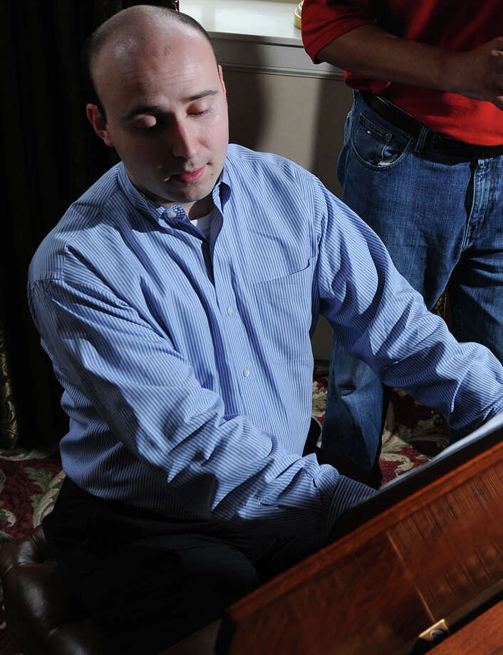 Craig Escamilla plays piano in this 2012 photo from The Enterprise archives. Photo: Guiseppe Barranco, STAFF PHOTOGRAPHER / The Beaumont Enterprise