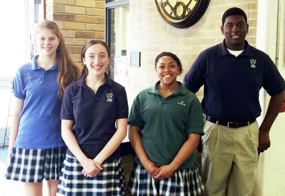 NOTRE DAME STUDENTS OF THE MONTH Notre Dame Catholic High School honored this quartet as its Students of the Month for March. From left are junior Michelle DeLeon, sophomore Alana Merly, senior Dy-Mond LeRoy and freshman Josh Jeudy.   They were nominated by faculty based on attitude, community service and academic achievement. Photo: Fairfield Citizen/Contributed / Fairfield Citizen