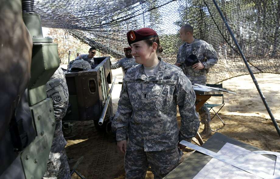 Lt. Kelly Requa watches over soldiers in the cannon platoon she leads at Fort Bragg, N.C., in February. Requa is one of at least eight female lieutenants who were brought in last year to lead field artillery units. Photo: Gerry Broome, Associated Press