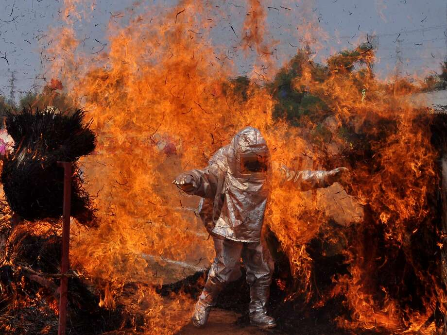 It's Fire Safety Week in India, and there's nothing safer than walking through a wall of