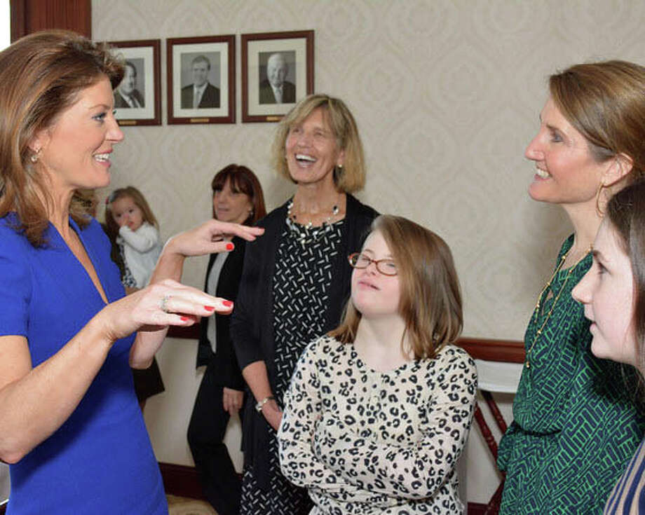 Norah O'Donnell meets with Molly, Meghan and Caroline Cioffi, as Barbara Fitzpatrick, director of STAR Rubino Family Center, looks on. O'Donnell spoke at the second annual Speakers Luncheon to benefit STAR, Inc., Lighting the Way Ö Photo: Contributed Photo, Contributed / New Canaan News Contributed