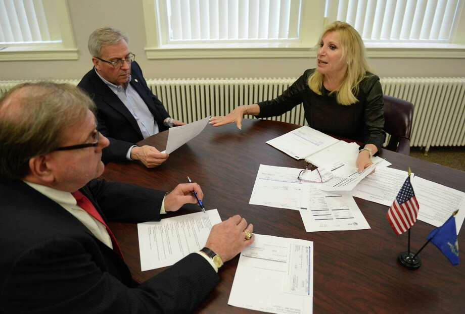 Lilli Steinberg, CEO of TRI Utility Cost Reductions, explains the utility refund being given to the town of Bethel with Comptroller Robert Kozlowski, left, and First Selectman Matt Knickerbocker at the Hurgin Municipal Center in Bethel, Conn. Tuesday, April 15, 2014.  Steinberg presented a refund of $52,000 for the savings found in the town's utility bills. Photo: Tyler Sizemore / The News-Times