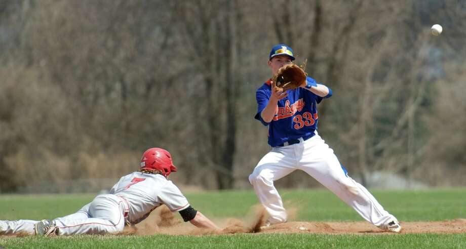 Danbury's Eric Cerno, #33, waits for the pickoff throw from the catcher as Kyle Dunster, #7, of Greenwich,jumps back to second during an FCIAC boys baseball game between Greenwich High School and Danbury High School on Monday, April 14, 2014, in Danbury, Conn. Photo: H John Voorhees III / The News-Times Freelance