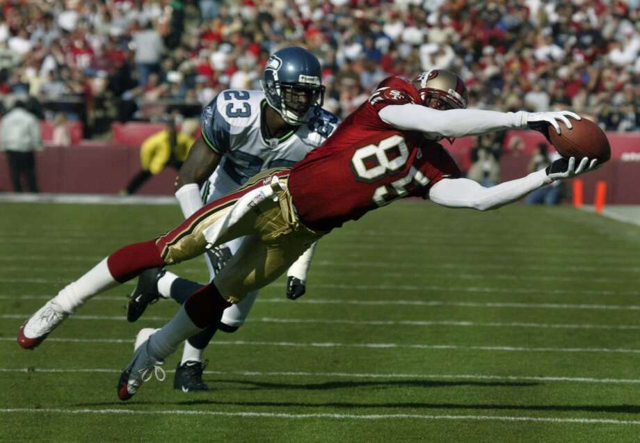 Brandon Lloyd catches a pss in the first quarter against #23 Marcus Trufant of the Seahawks. Photo: Liz Mangelsdorf, SFC