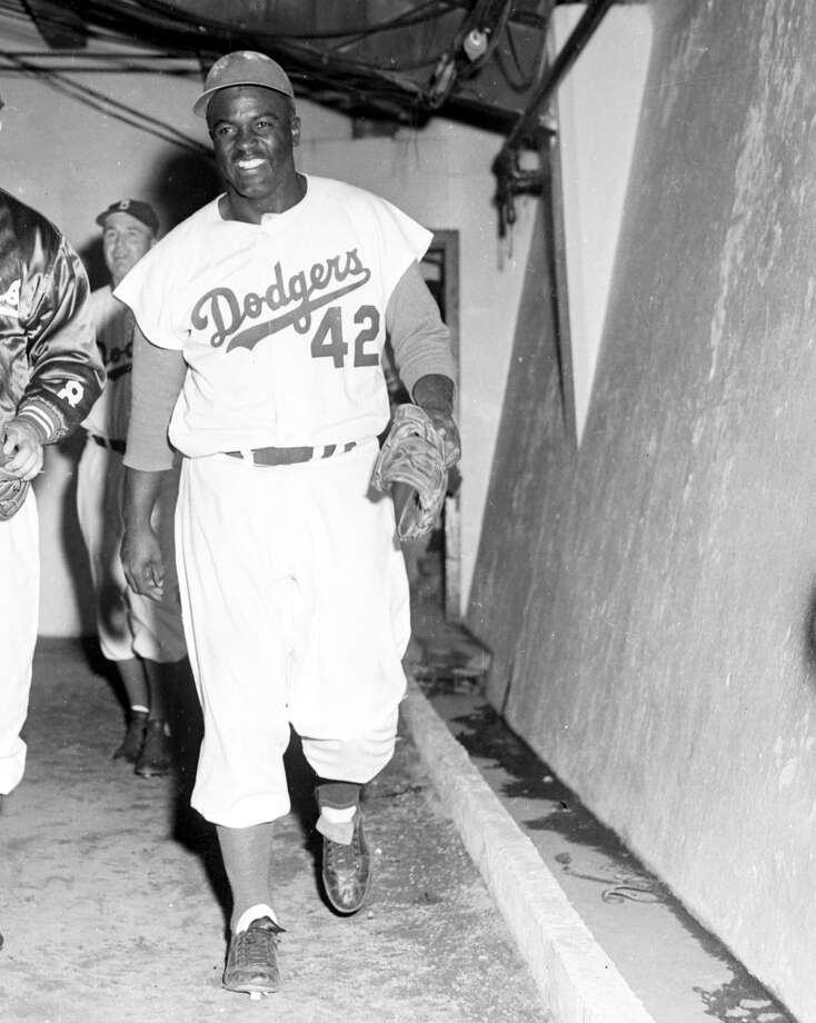 Jackie Robinson  Position: Infielder  Team: Brooklyn Dodgers  Career: 1947-1956 Photo: Kidwiler Collection, Diamond Images/Getty Images
