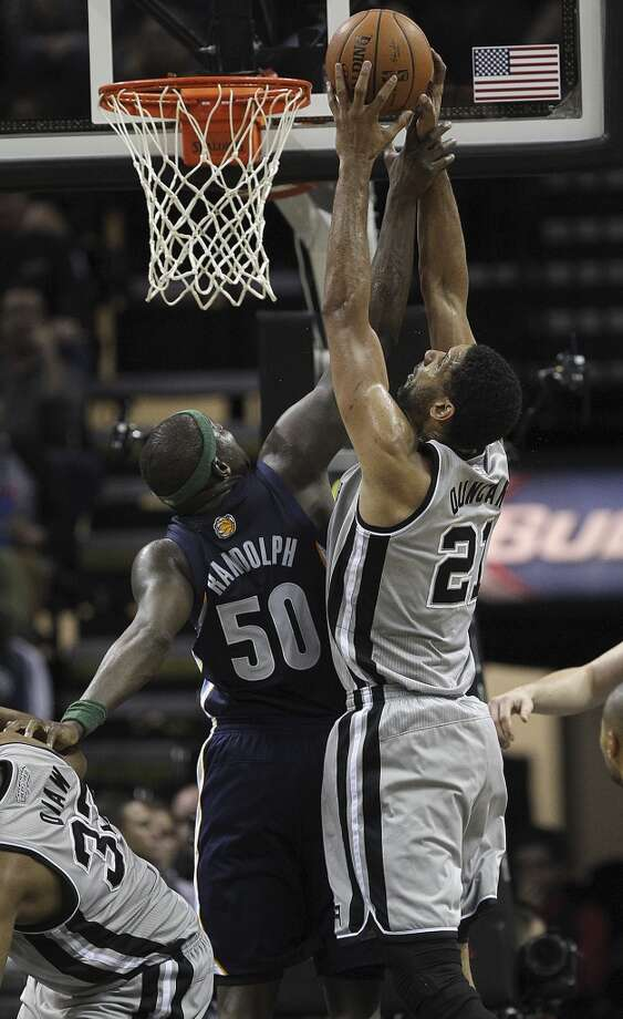 San Antonio Spurs' Tim Duncan goes for a rebound against Memphis Grizzlies' Zach Randolph during the first half at the AT&T Center, Sunday, April 6, 2014. Photo: Jerry Lara, San Antonio Express-News