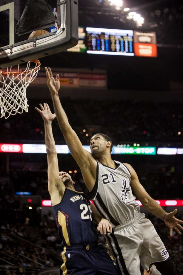 Tim Duncan takes a shot against the New Orleans Pelicans in the second half, Saturday March 29, 2014 at the AT&T Center. The Spurs kept a steady lead throughout the entire game and won 96-80. Photo: Julysa Sosa, For The San Antonio Express-News