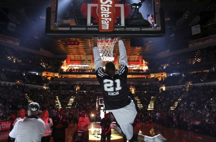 San Antonio Spurs' Tim Duncan hangs from the basket before the game with the 76ers Monday March 24, 2014 at the AT&T Center. Photo: Edward A. Ornelas, San Antonio Express-News