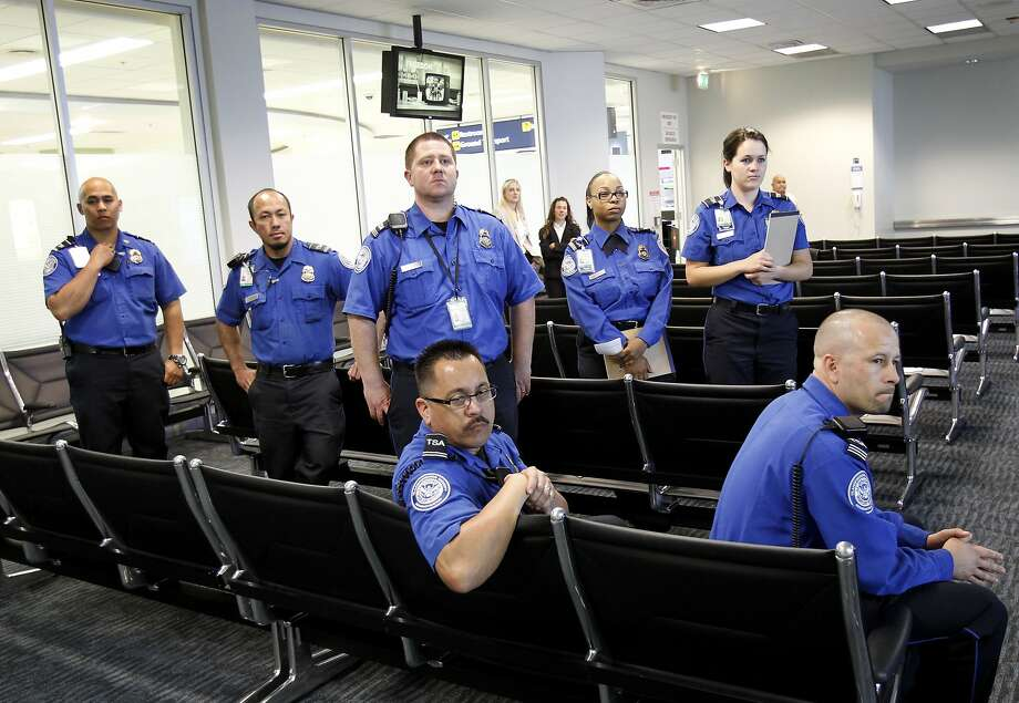 TSA workers waited for the instruction to begin at Oakland International airport Tuesday April 15, 2014. Oakland International airport workers were given special training on spotting human traffickers and sexual exploiters of children. Photo: Brant Ward, The Chronicle