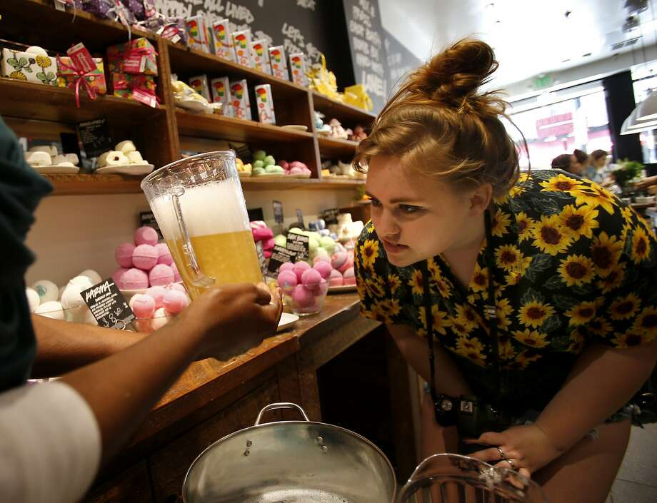 Caelan Wright got a close look at a natural bubble bath at LUSH Tuesday April 15, 2014 in San Francisco, Calif. LUSH products use natural ingredients instead of plastic microbeads in their skin and bathing items. A bill in the legislature would require all companies to begin using natural exfoliates. Photo: Brant Ward, The Chronicle