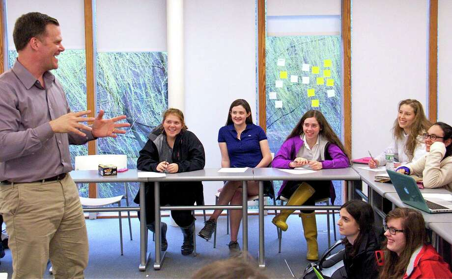 Poet Taylor Mali shares a laugh with Greenwich Academy upper-school students during a writing workshop  at the school in Greenwich Conn. on Tuesday April 15, 2014. Photo: Contributed Photo / Greenwich Time Contributed