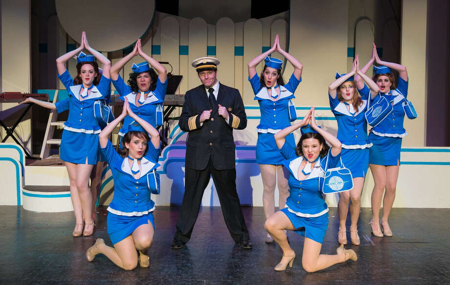 "Brian Hodges (center) plays a young con man in the Woodlawn Theatre's staging of ""Catch Me If You Can."" Photo: Courtesy Photo / sRagnar Fotografi"