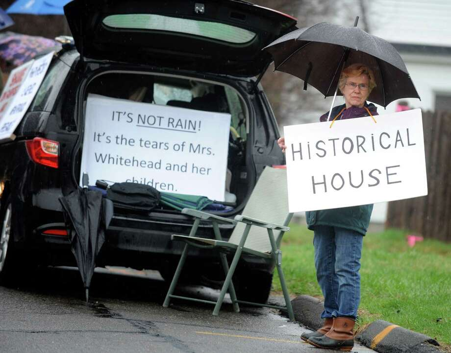 Noreen Salce, of Fairfield, protests the demolition of the former home of aviation pioneer Gustave Whitehead Tuesday, April 15, 2014, outside the house on Alvin Street in Fairfield, Conn. Photo: Autumn Driscoll / Connecticut Post