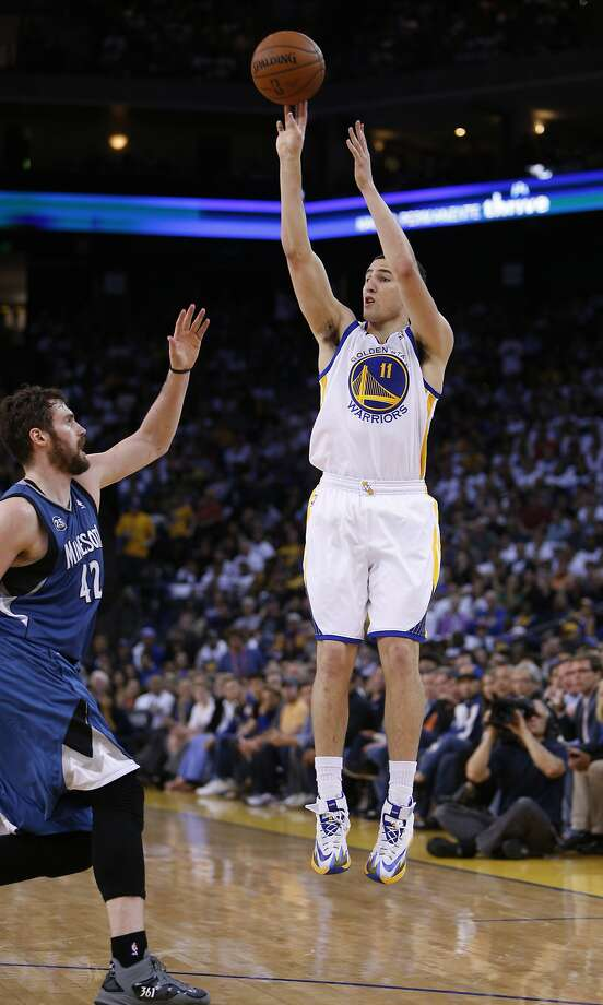 Klay Thompson (11) shoots over Kevin Love (42) in the first half. The Golden State Warriors played the Minnesota Timberwolves at Oracle Arena in Oakland, Calif., on Monday, April 14, 2014. Photo: Carlos Avila Gonzalez, The Chronicle