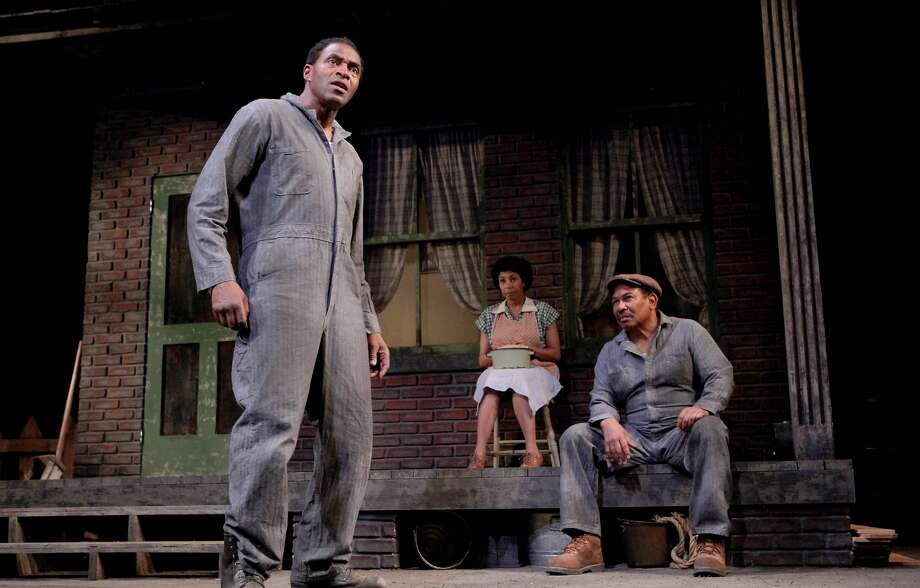 "Troy Maxson (Carl Lumbly, left) and fellow garbageman Jim Bono (Steven Anthony Jones) discuss a confrontation as Troy's wife Rose (Margo Hall) listens in August Wilson's ""Fences"" at Marin Theatre Company. Photo: Ed Smith / ONLINE_YES"