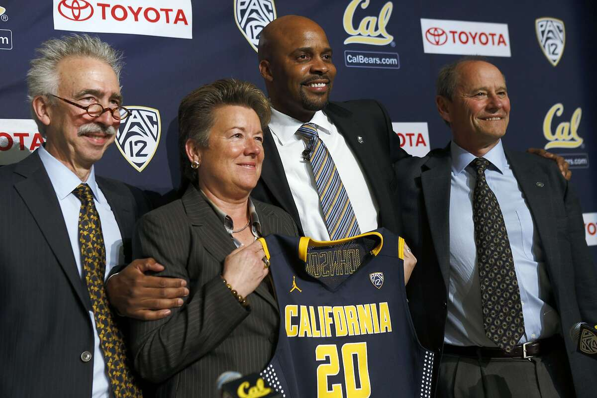 Chancellor Nicholas Dirks, Athletic Director Sandy Barbour, Cuonzo Martin, and Vice Chancellor John Wilton pose after the University of California Berkeley announced its new mens' basketball coach Cuonzo Martin at Memorial Stadium in Berkeley, Calif., on Tuesday, April 15, 2014.