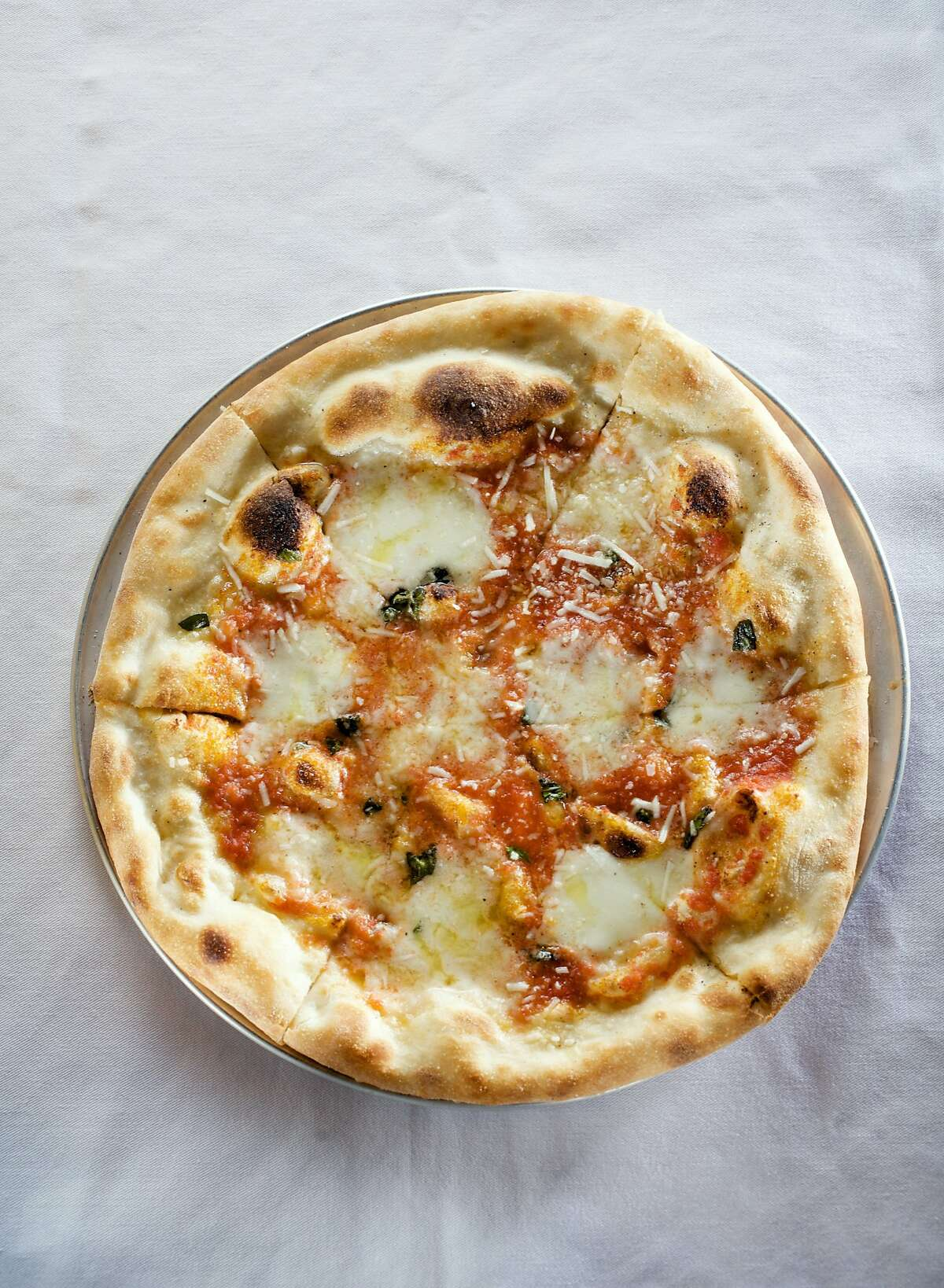 OAKLAND, CALIF - MARCH 7: The Bufala Mozzarella and Oregano Pizza at Dopo. BY JOHN LEE / SPECIAL TO THE CHRONICLE
