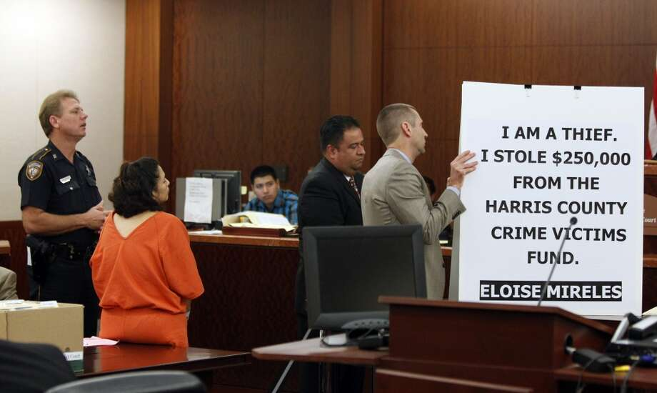 Eloise Mireles, second from left, in the 177th State District Court  at the Harris County Criminal Courthouse, 1201 Franklin, during an appearance before Judge Kevin Fine on Wednesday, Dec. 22, 2010, in Houston. She and her Daniel Mireles were both convicted in theft from the Harris County District Attorney's Office where she worked.  Part of their punishment included carrying a sign along Westheimer across the street from the Galleria near the intersection of Post Oak.   ( Melissa Phillip / Houston Chronicle ) Photo: Melissa Phillip, Houston Chronicle
