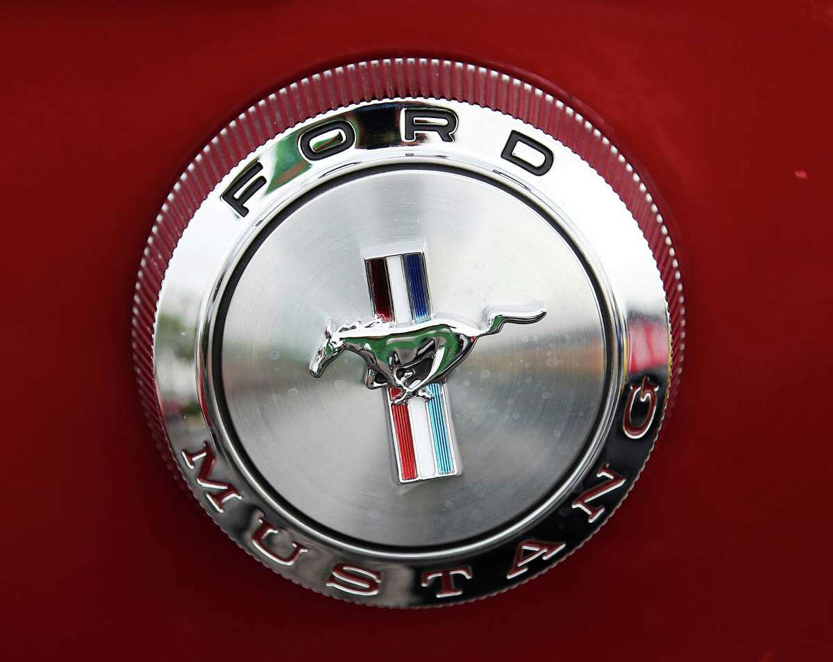 Detail of the Ford Mustang rear emblem on a 1966 Ford Mustang during a gathering at the Cars and Coffee event on Saturday, Apr. 12, 2014. The ubiquitous Mustang and its owners will be celebrating the 50th anniversary this month.