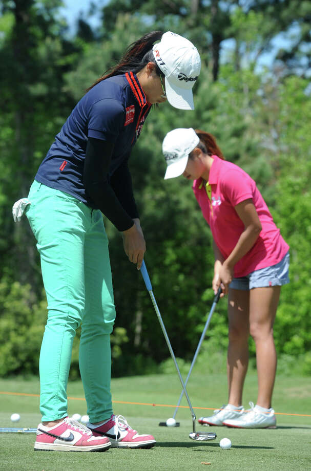 Lamar's Wenny Chang, left, and Nghi Ngo practice putting at the Beaumont Country Club on Thursday. The duo are part of the Lady Cardinals golf team that will compete in the Southland Conference tournament this week.  Guiseppe Barranco/@spotnewsshooter Photo: Guiseppe Barranco, Photo Editor