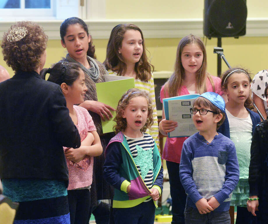 Children sing during the Congregation Shir Ami second-night Seder celebrating Passover at the First Presbyterian Church in Greenwich, Tuesday, April 15, 2014. Photo: Bob Luckey / Greenwich Time