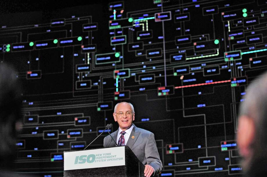 U.S. Congressman Paul Tonko addresses those gathered  during an unveiling of the NYISO control center on Tuesday, April 15, 2014, in North Greenbush, N.Y.  The large display screen in the background is used by workers in the control center to view the power throughout New York State.   (Paul Buckowski / Times Union) Photo: Paul Buckowski / 00026489A