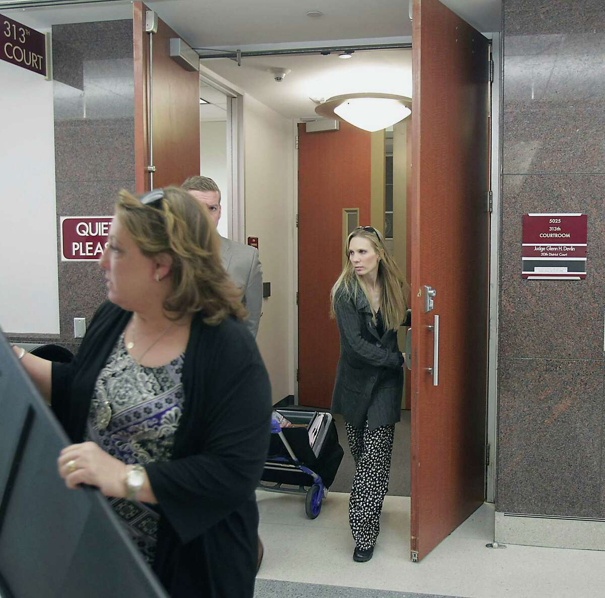Tami Bleimeyer, right, leaves court in 2014 after a judge ruled that her six children should have no contact with her.