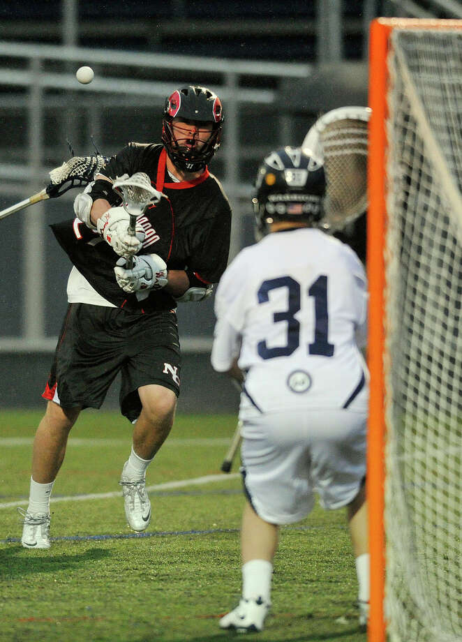 New Canaan's Kyle Smith shoots on Wilton goalie Joshua Worley during their lacrosse game at Wilton High School in Wilton, Conn., on Tuesday, April 15, 2014. Photo: Jason Rearick / Stamford Advocate