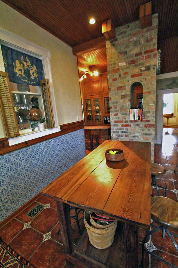 Jerry Lockey built the table in the kitchen and installed the brick around the support column. He also gave the kitchen a bead board ceiling. Photo: Danny Warner, For The Express-News