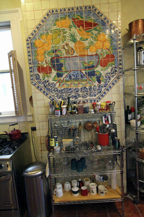 While in Mexico, Jerry Lockey and Dara Anderson found a tile mural in a box, in pieces and bought it, not knowing if it would fit in their kitchen. It does, perfectly. Open shelves allow Lockey to easily reach everything when he's cooking. Photo: Danny Warner, For The Express-News